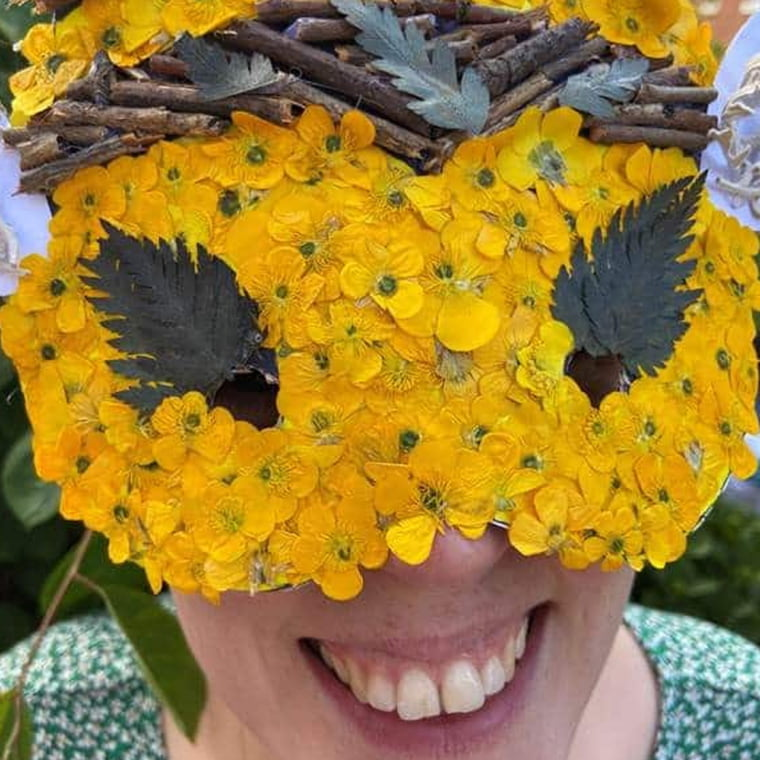 Lady Wearing A Mask to look like a bee