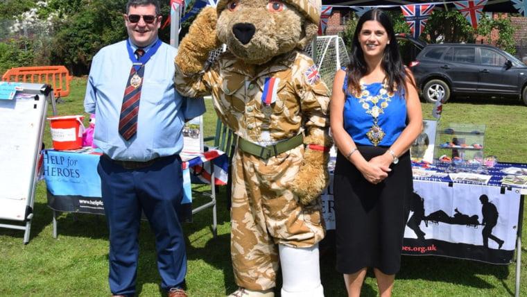 Mayor Kath Hay with a military charity mascot
